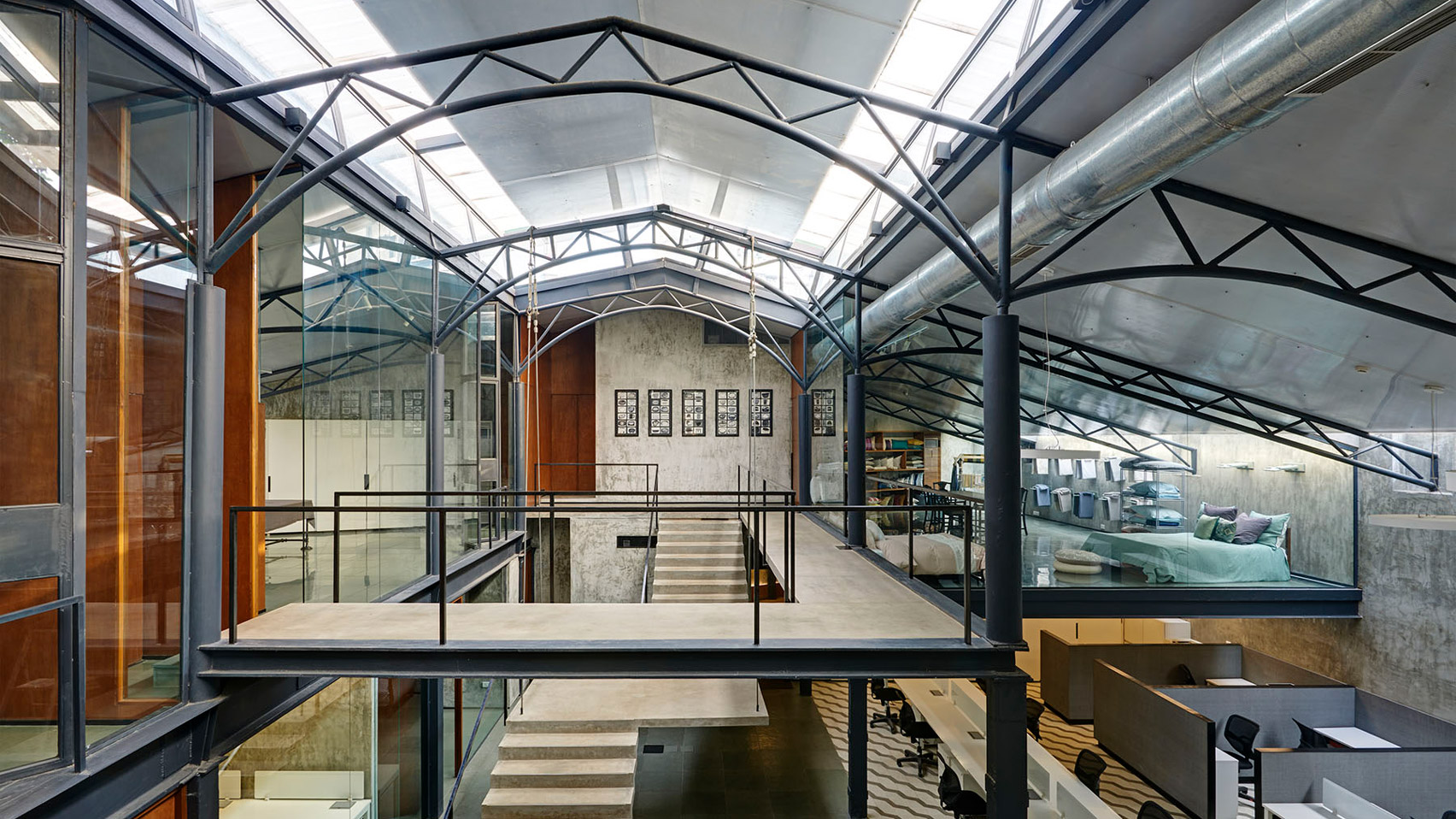 Offices in a converted warehouse centre around suspended