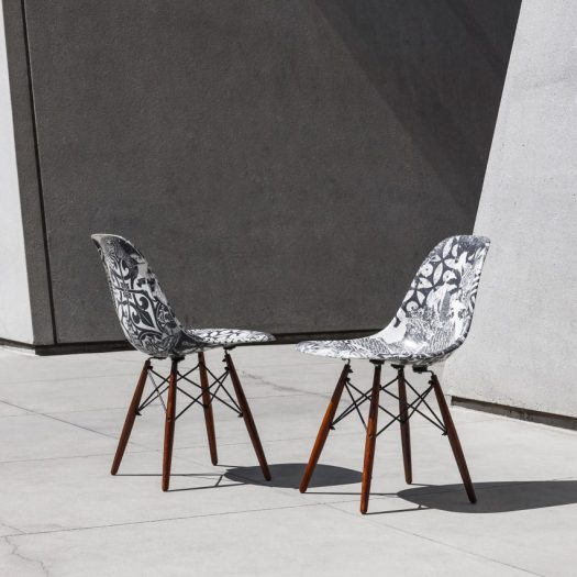 Shepard Fairey and Keith Haring artworks applied to mid-century chairs