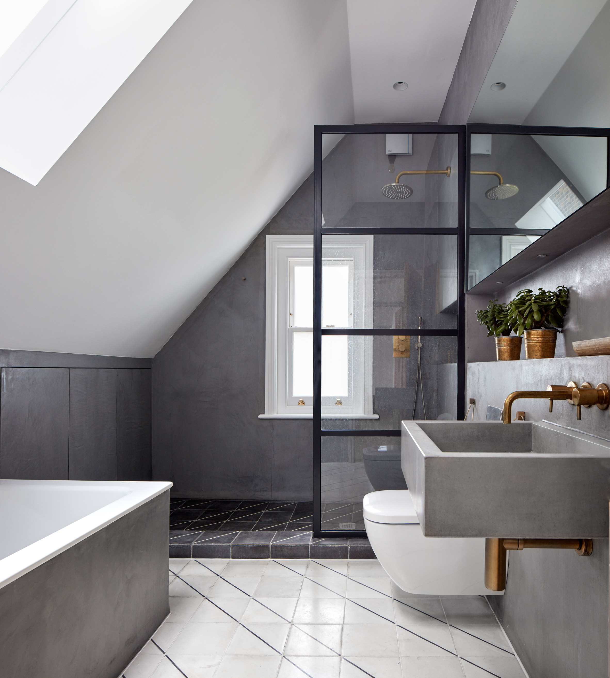 Merrett Houmøller Architects has renovated and extended a townhouse in north London
