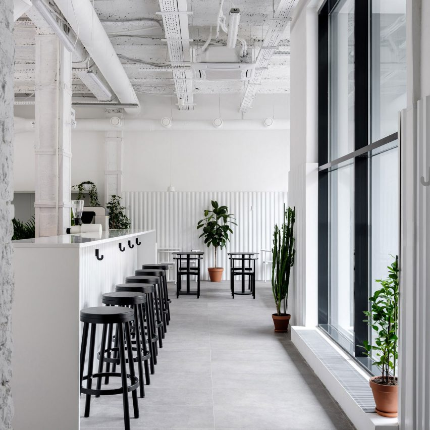 Asketik Creates Stark White Coffee Shop In Soviet Silk Factory