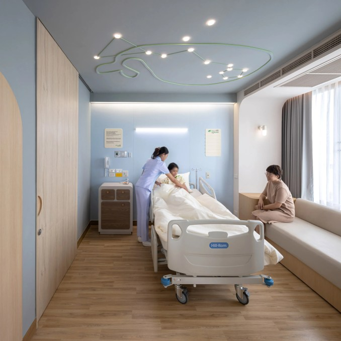 Children's hospital room with whale ceiling light by Integrated Field