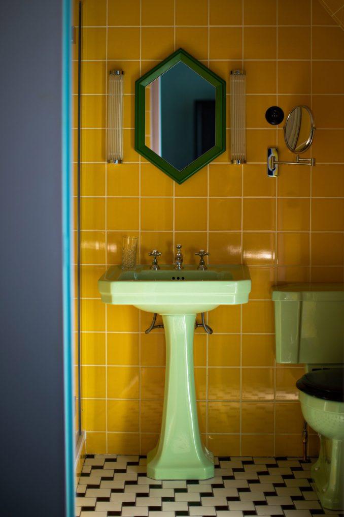 Tiled bathrooms inside Hotel Les Deux Gares in Paris