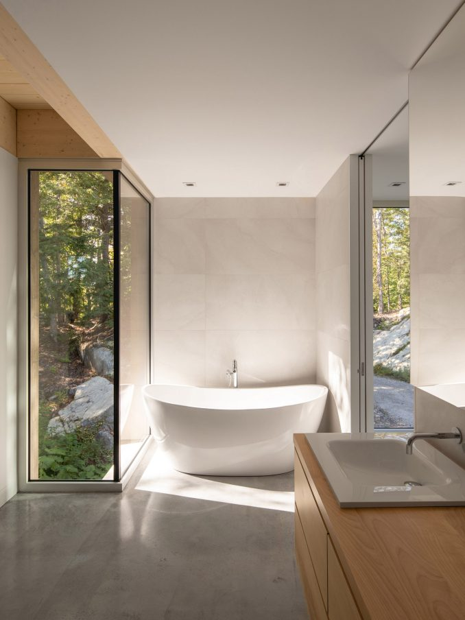 Master bathroom in Forest House I by Natalie Dionne Architecture