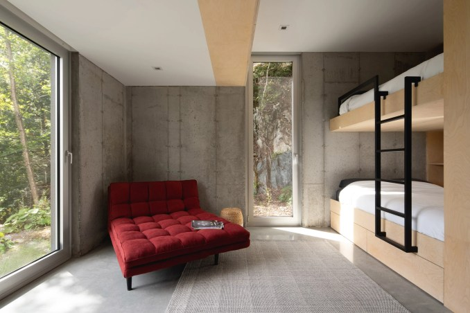 Sofa in bunk room of Forest House I by Natalie Dionne Architecture