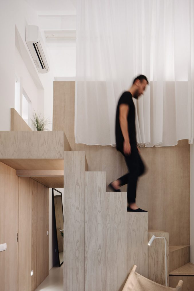 Stairs leading to mezzanine of of Project #13 by Studio Wills + Architects