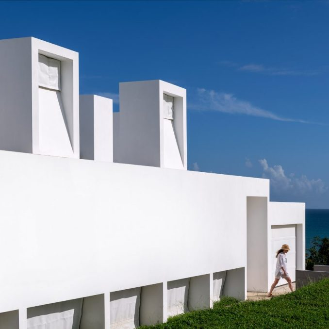 The white concrete walls of Casa Flores by Fuster + Architects
