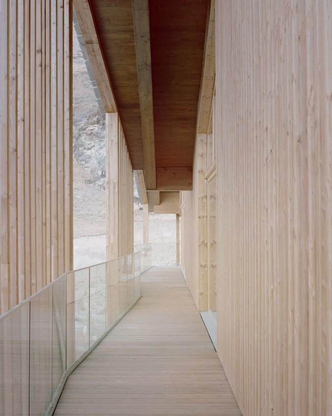 A timber terrace of an Italian mountain chalet