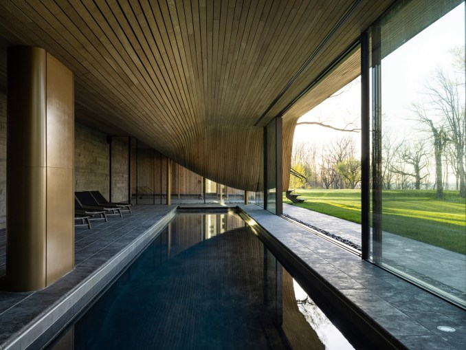 Pool and compression-bent wood cieling in floor houe