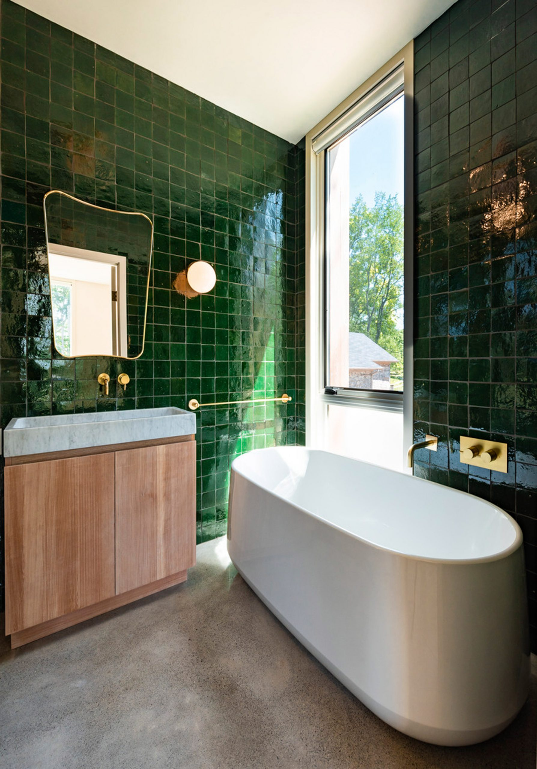 Bathroom with green times Fold House by Partisans