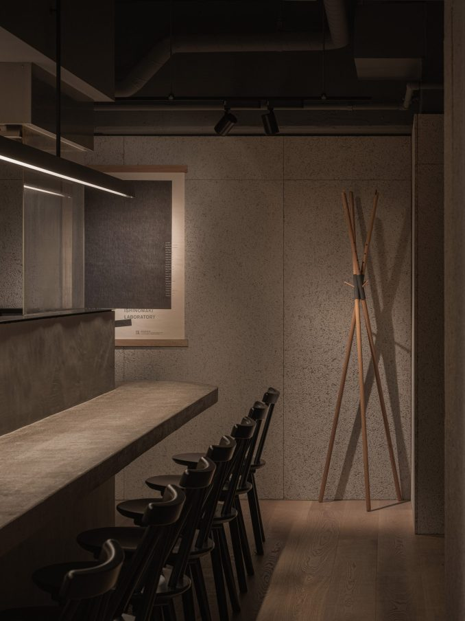 Concrete counter and wood wool cement board walls in Grillno restaurant interior