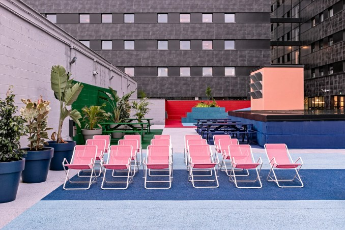 The multicoloured terrace has different seating areas