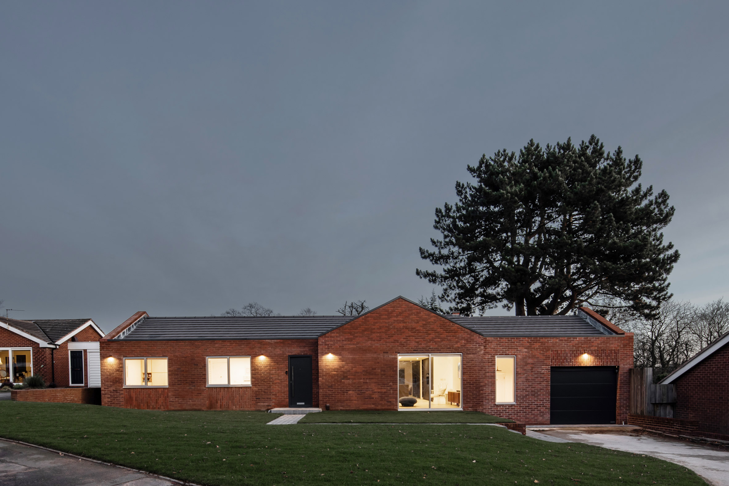 Facade of Honey and Walnut House renovated bungalow by Intervention Architecture