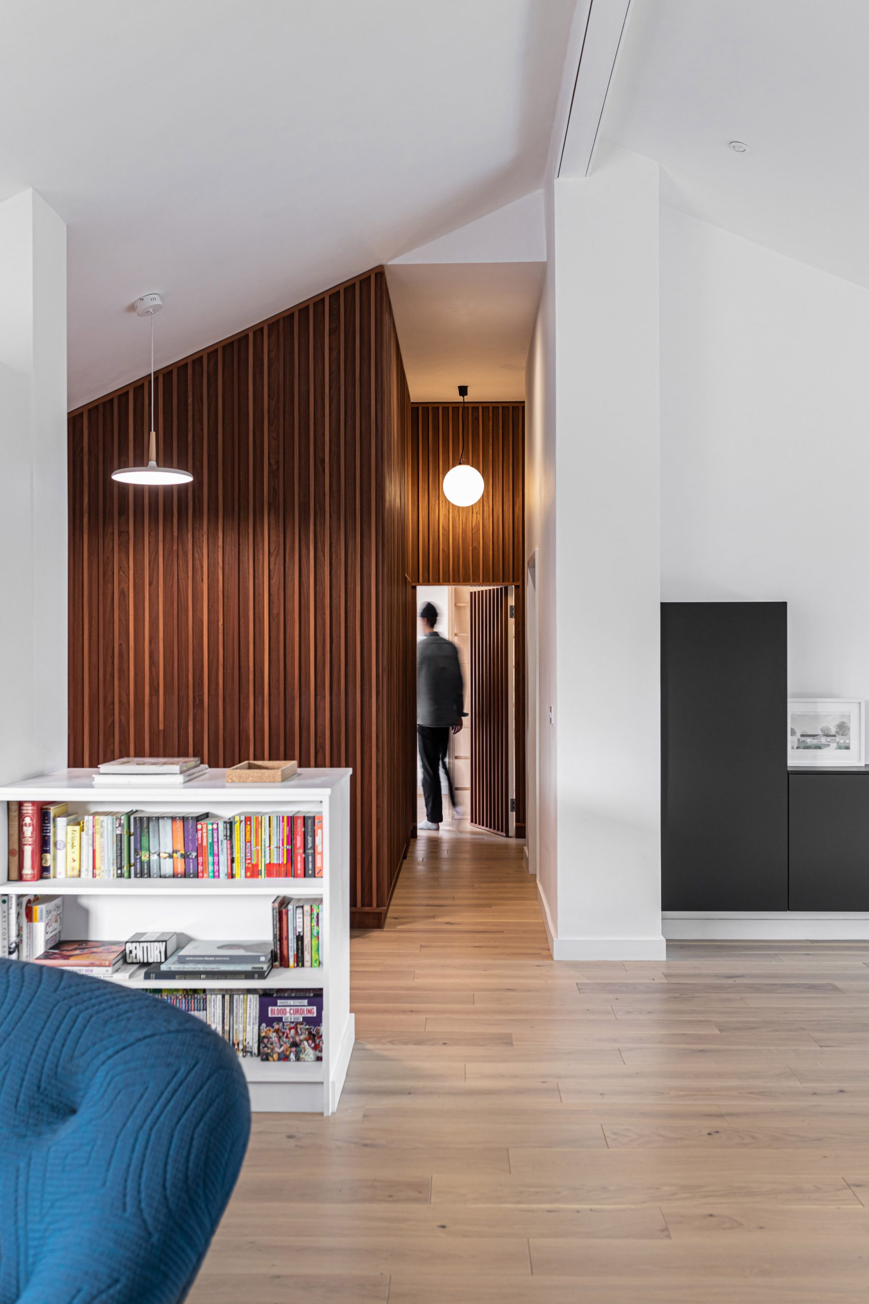 Living spaces in Honey and Walnut House by Intervention Architecture