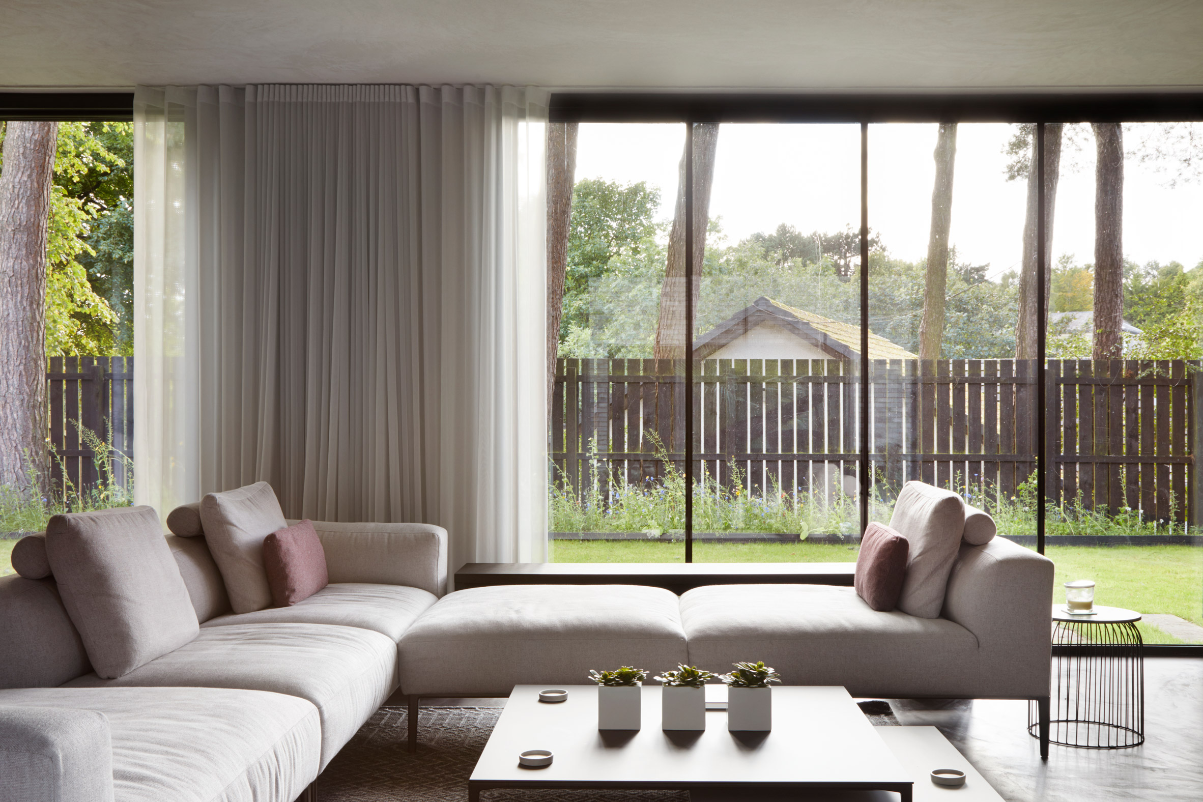 A glass-lined living room in a Scottish house by McGinlay Bell