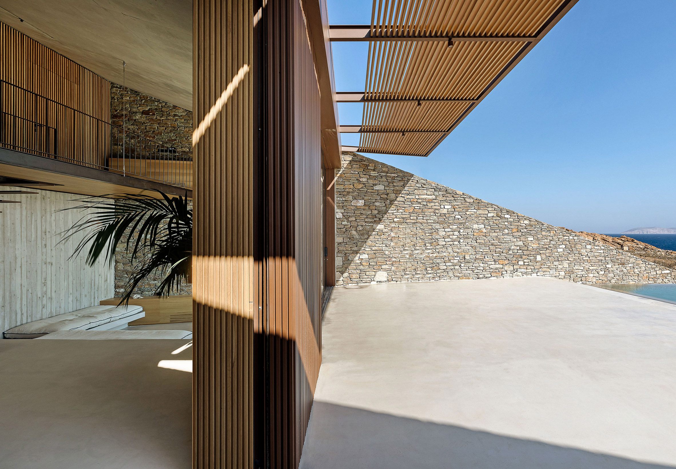 Stone angled wall runs through the entire home