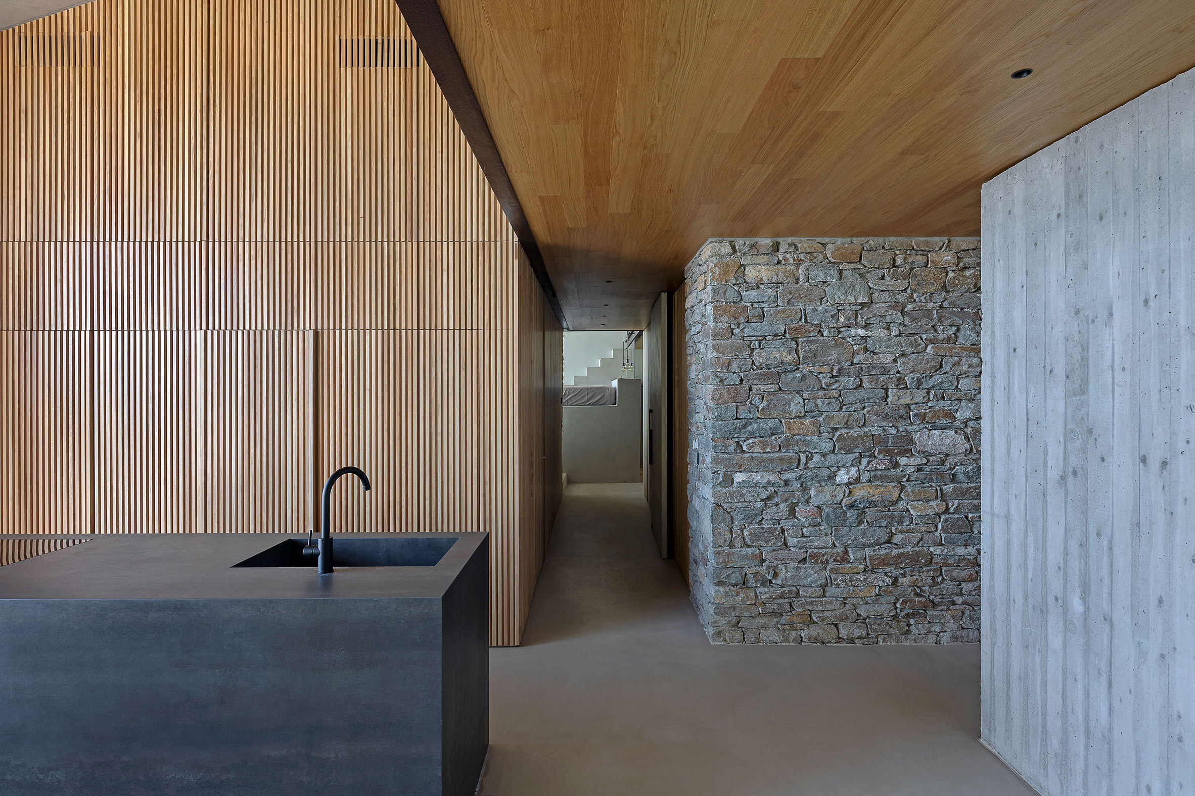 Timber lined kitchen by Mold Architects