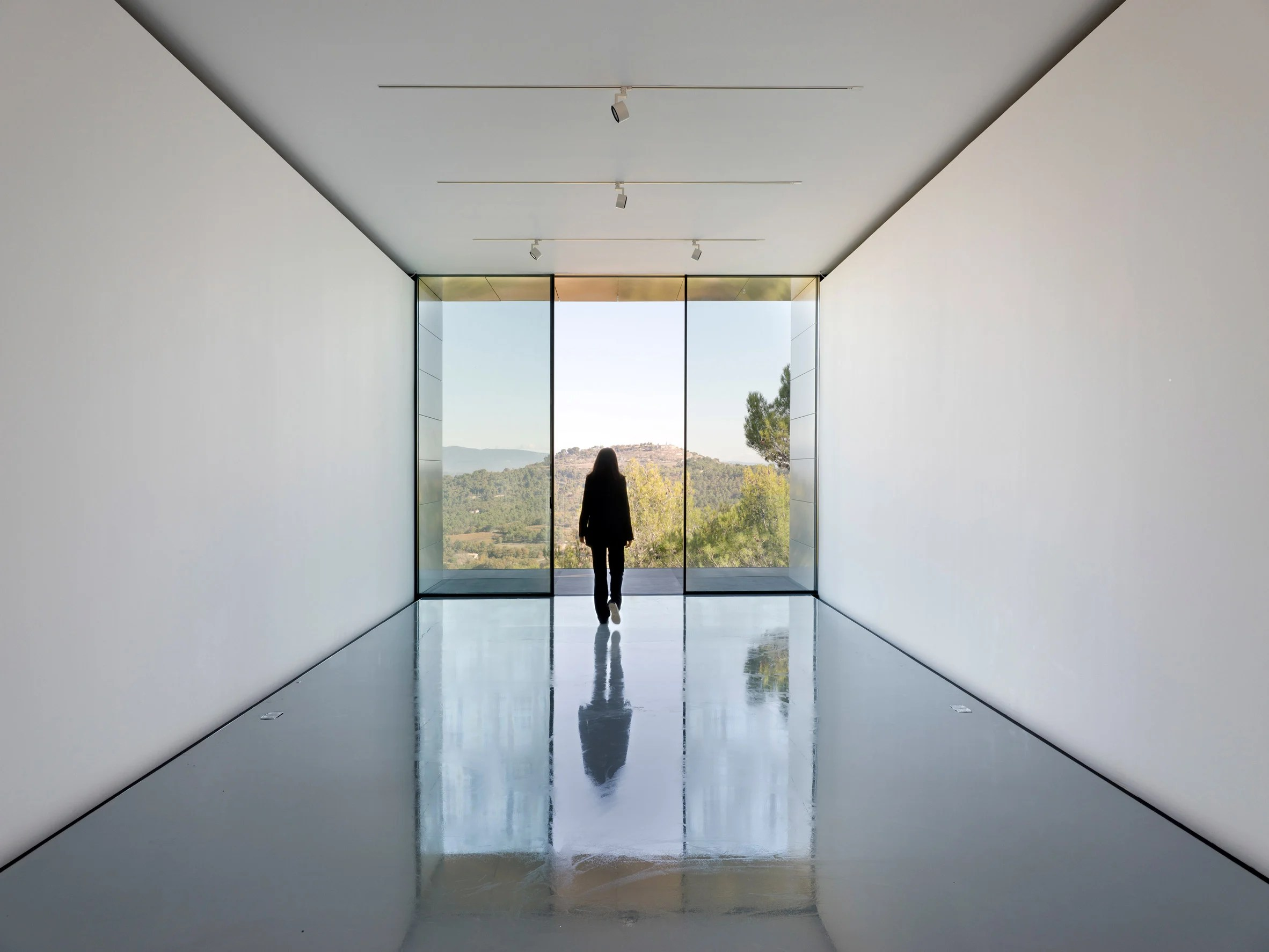 Gallery with views across a vineyard