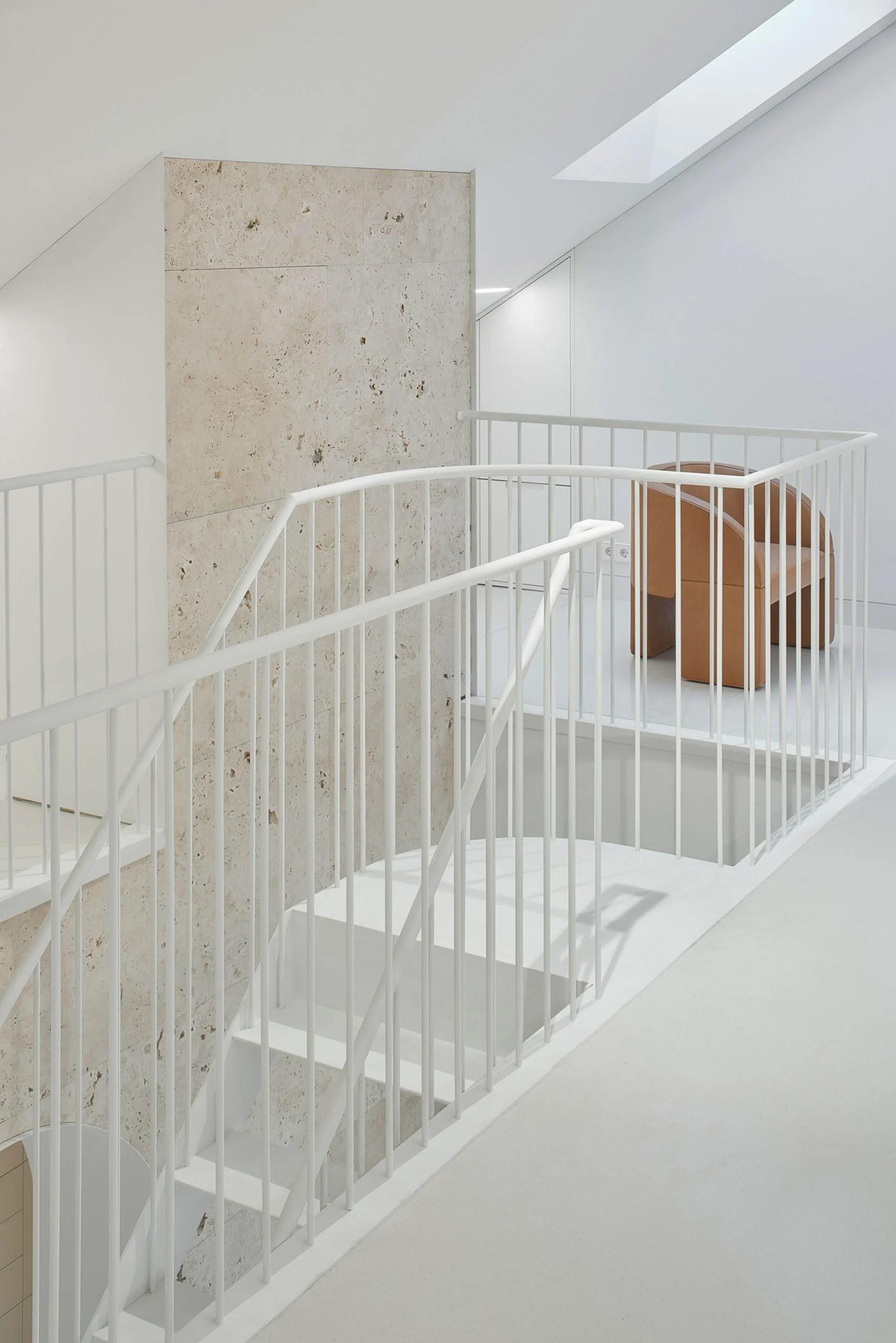 White steel staircase in Vilnius apartment by 2XJ