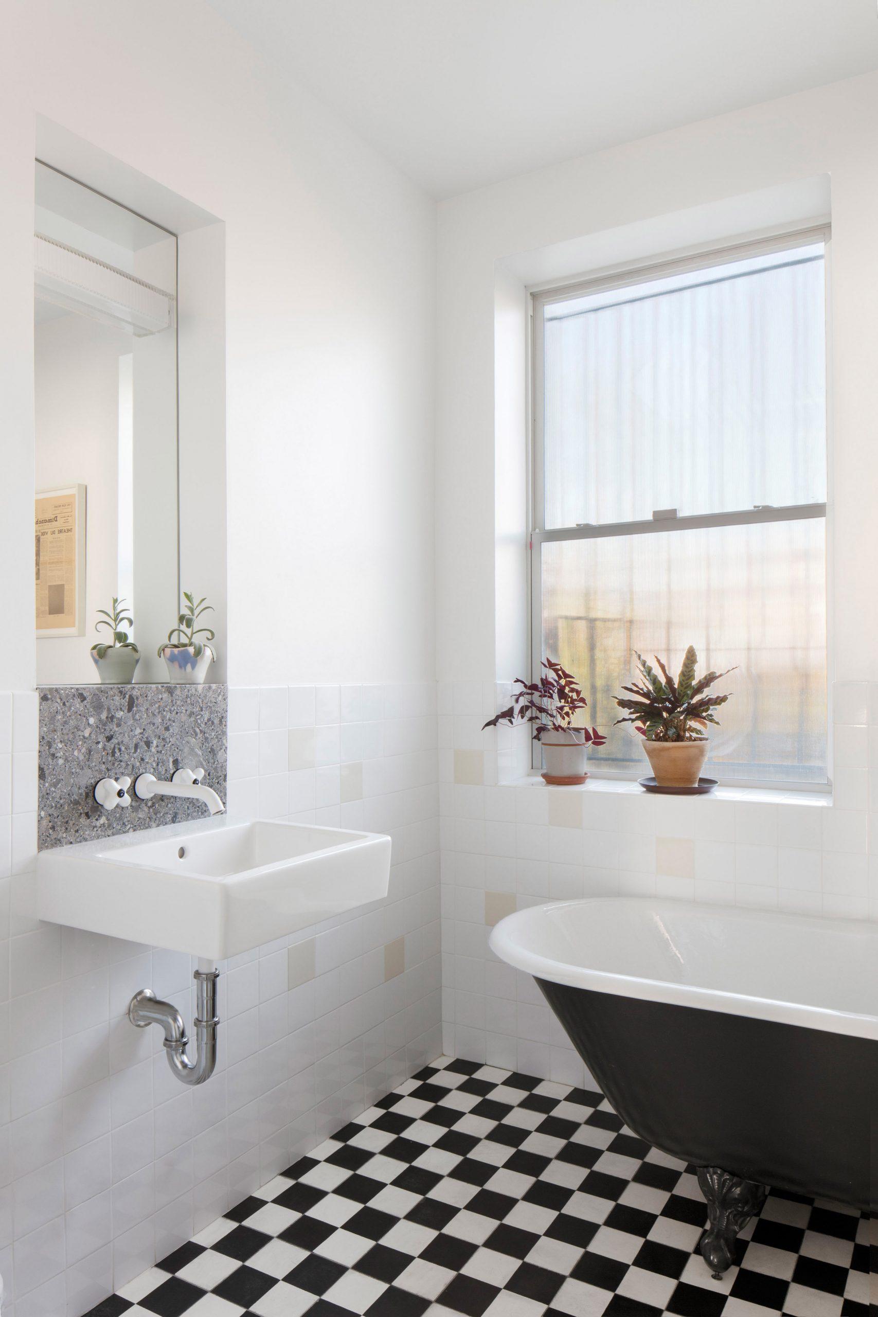 The bathroom has surplus cement tiles