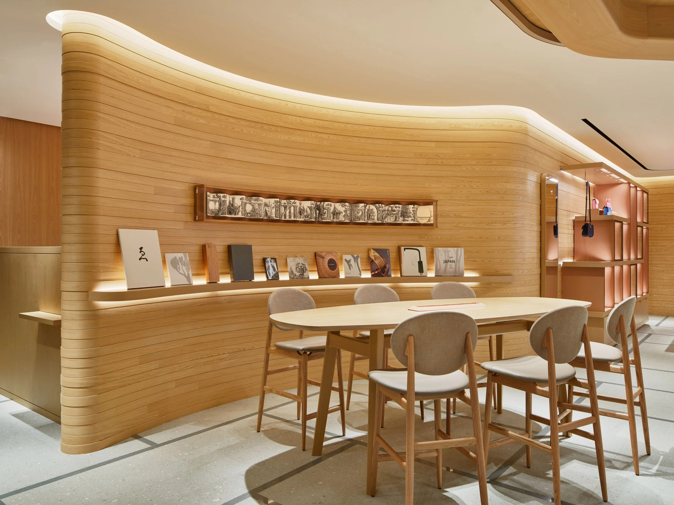 A shop interior with curved wooden walls
