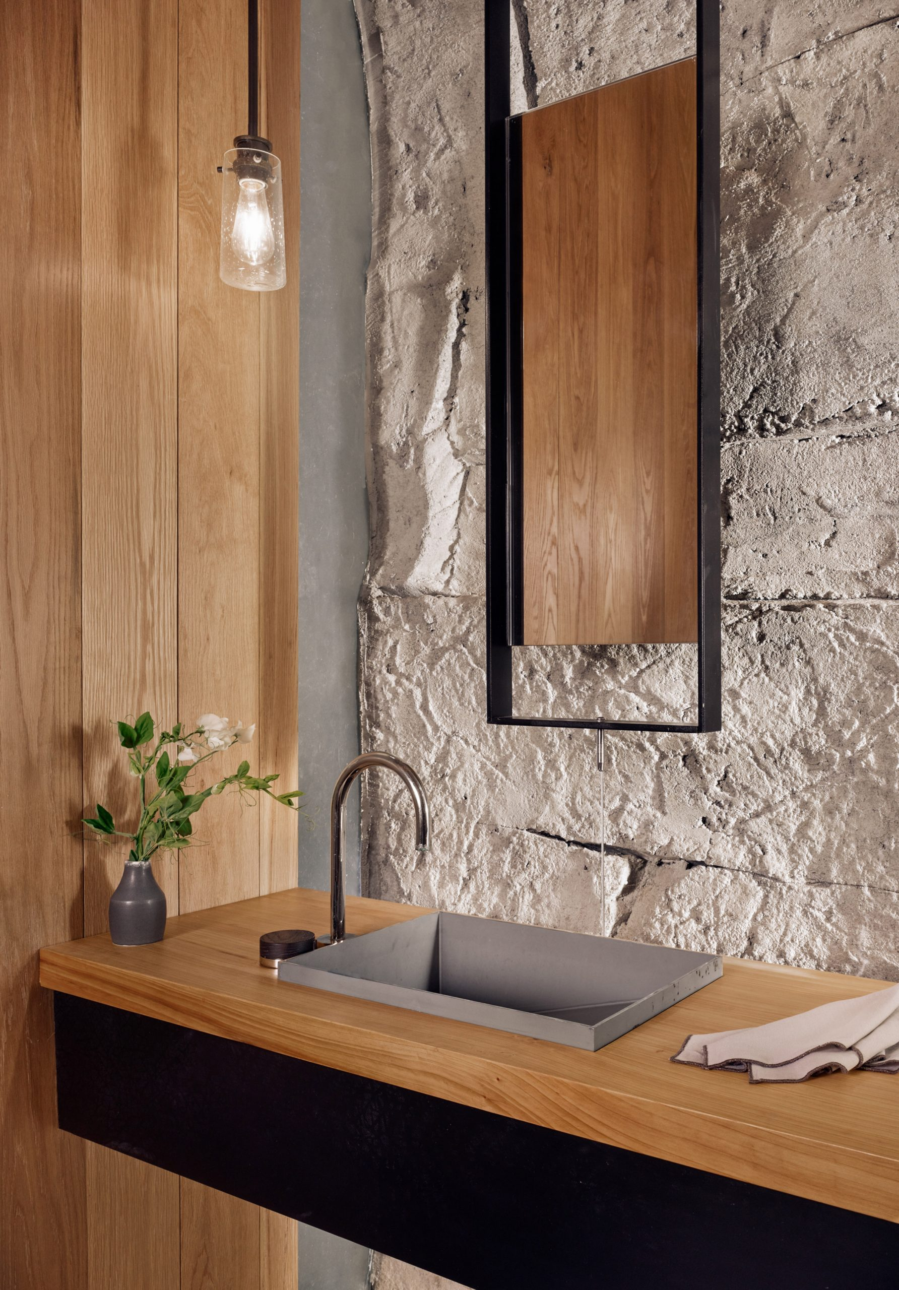 Bathroom with sprayed concrete walls in a Texas wine cellar