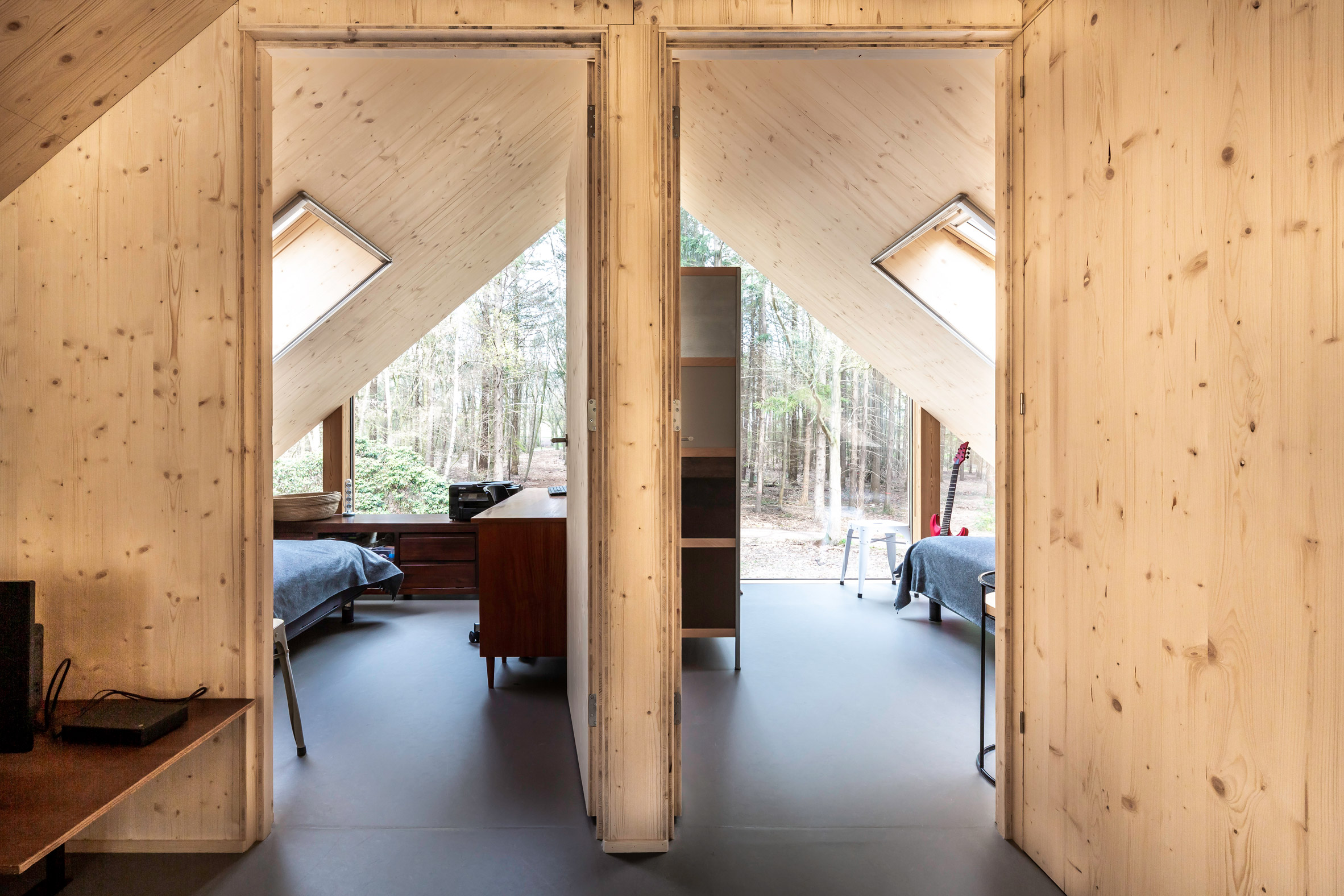 Wood-lined bedrooms in a forest cabin