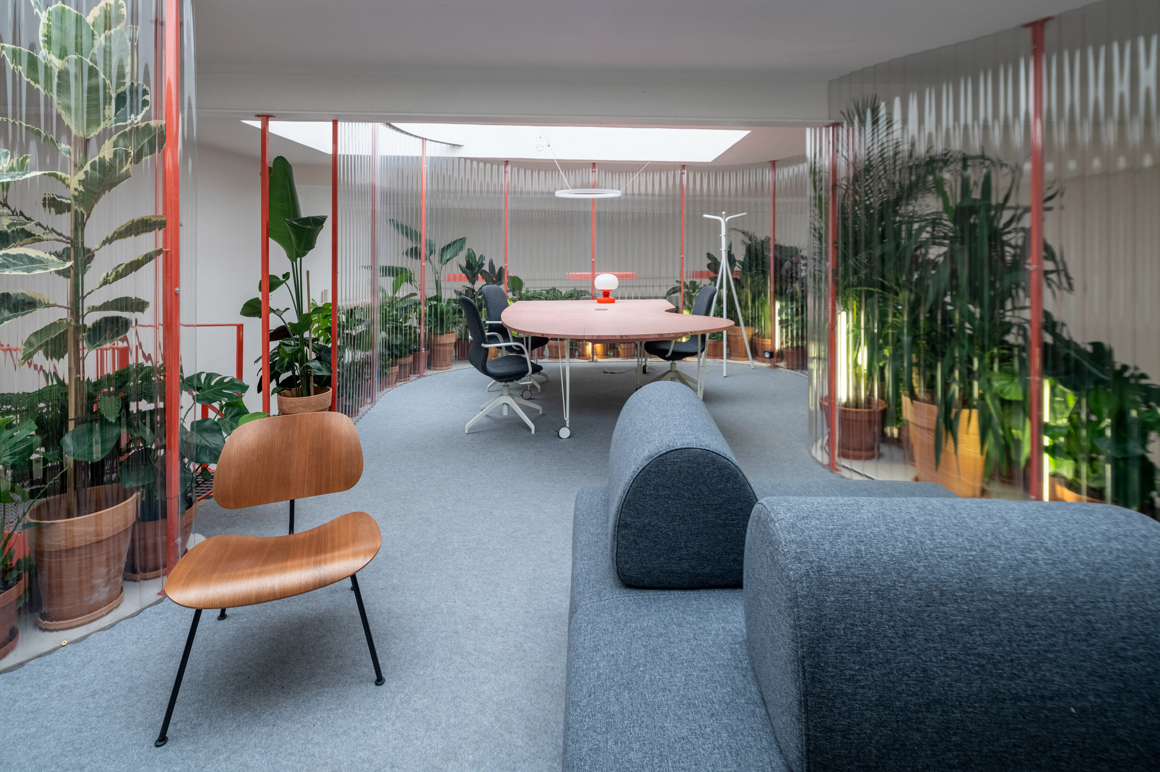 Mezzanine workspace area wrapped in transparent corrugated plastic in Grounds Coffee Hub