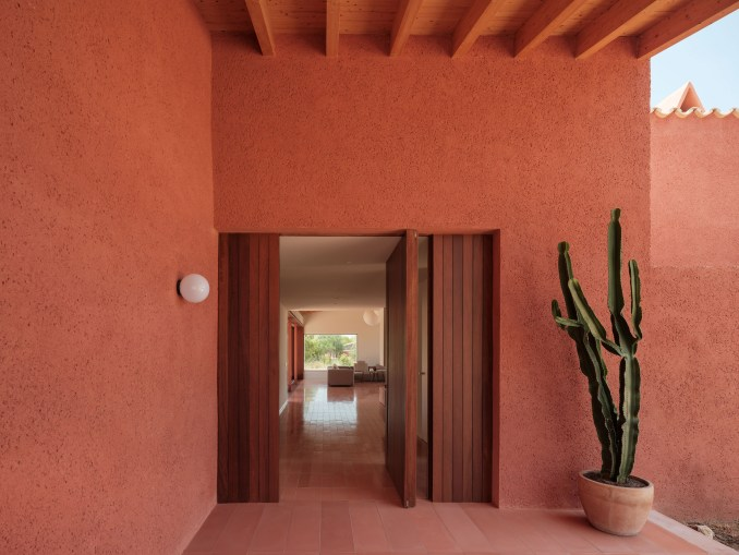A sheltered entrance area with a pivoting door