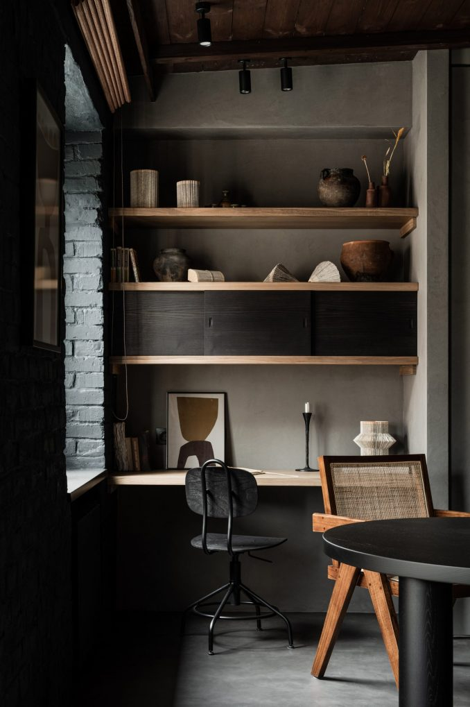 Dining table and home office with built-in storage in interior by Olga Fradina
