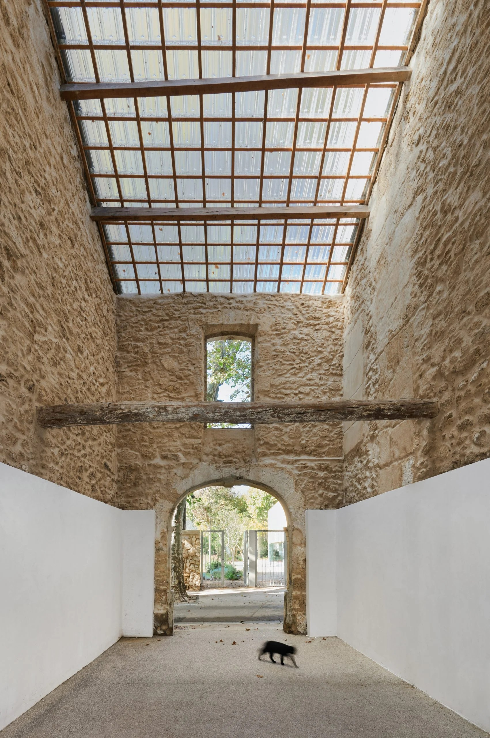 Original beams and stone are preserved in the passageway