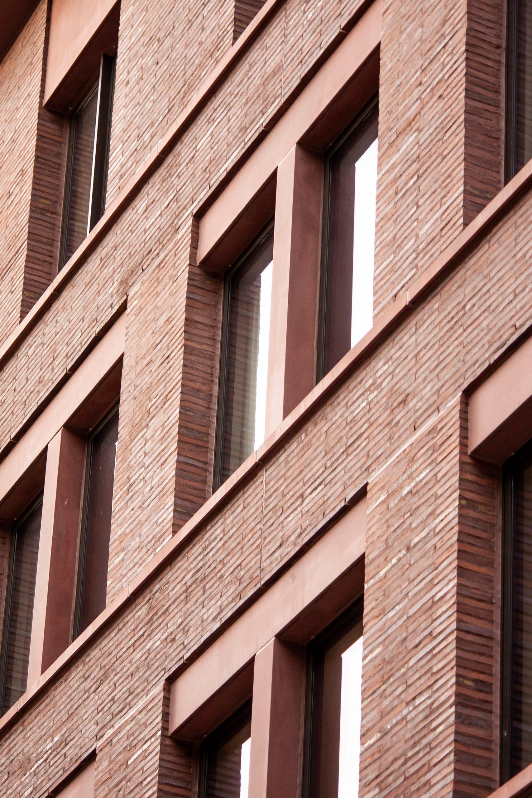 Roman brick and red concrete of 11-19 Jane Street