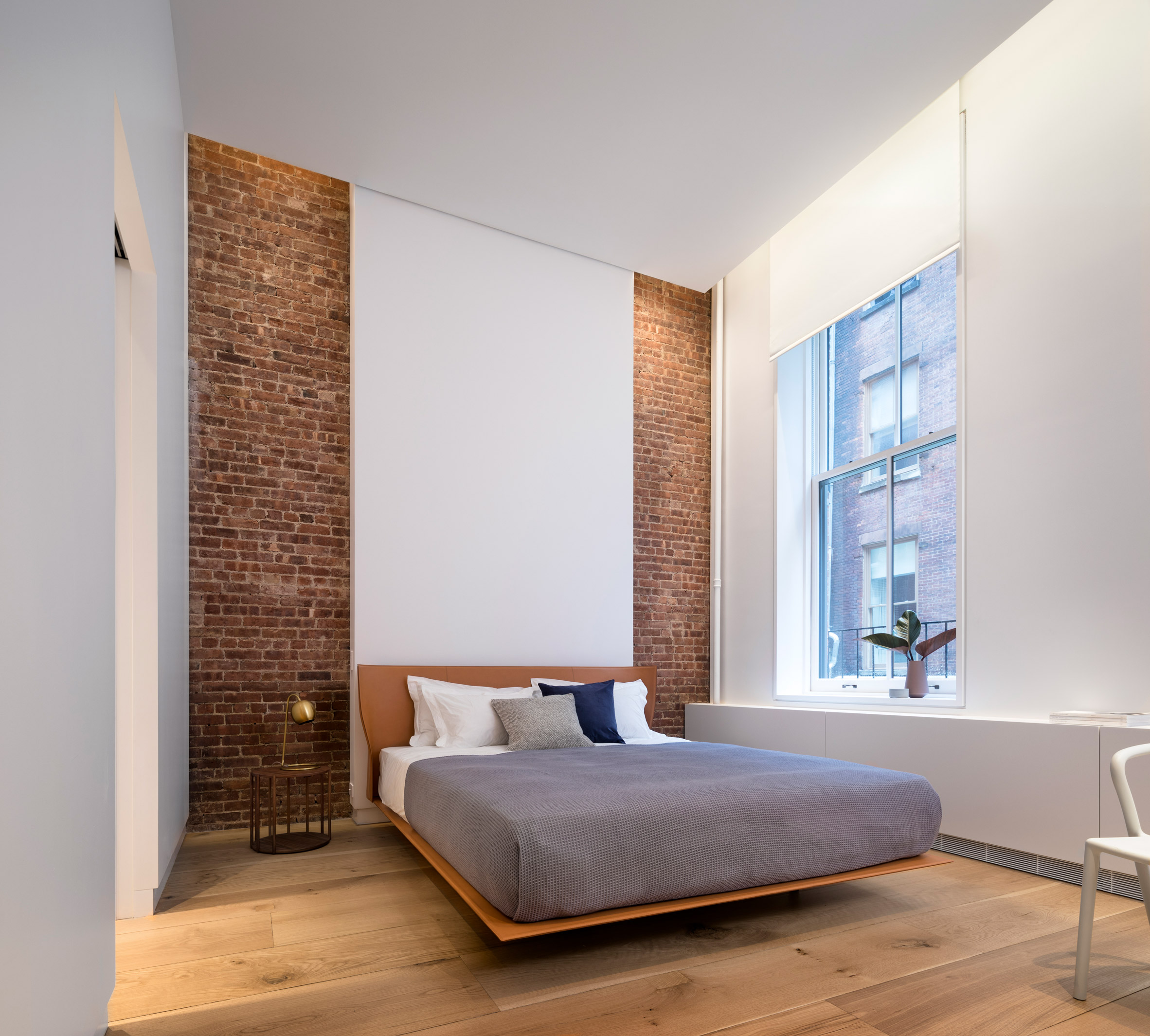BC—OA incorporated brick party walls into the space