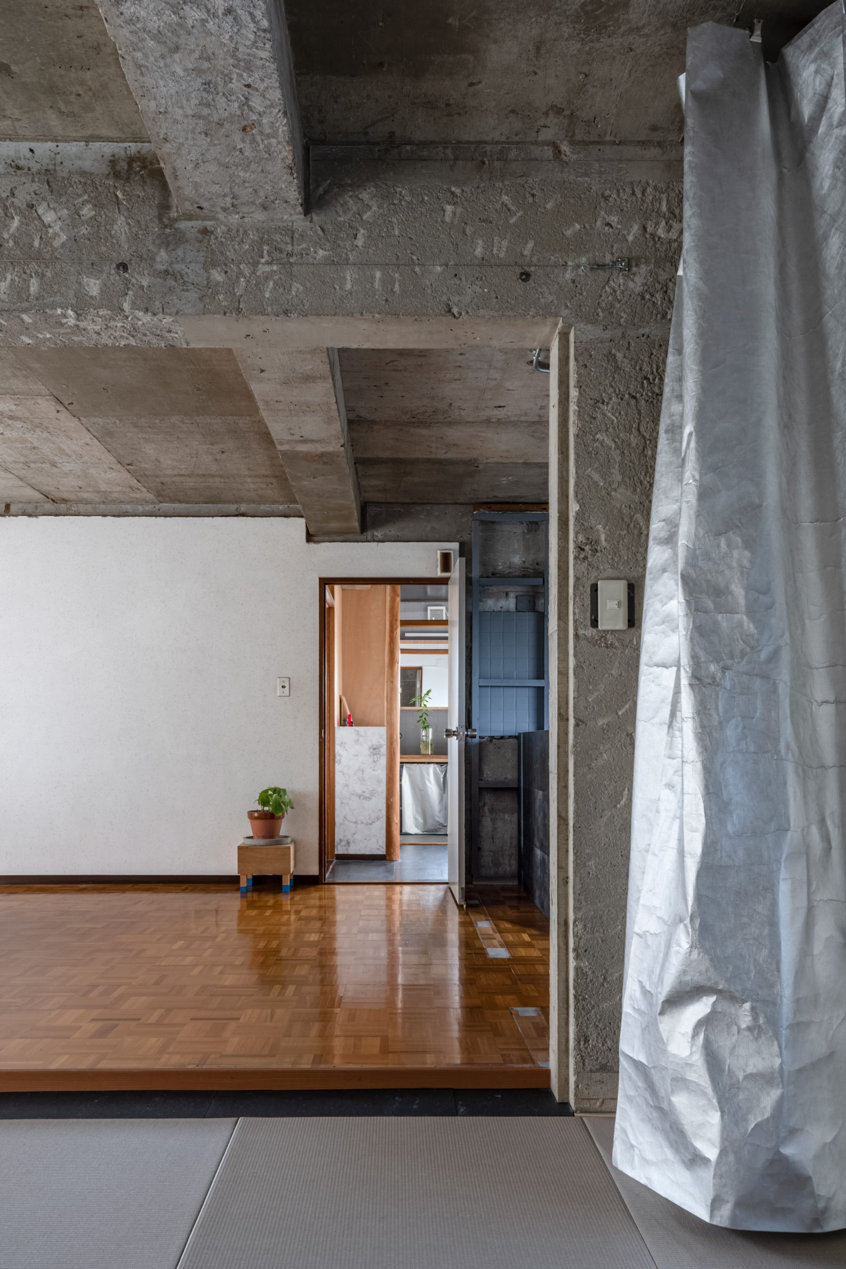 Silver curtain in reception room by Nanometer Architecture