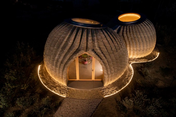 The 3D-printed home has a ribbed exterior