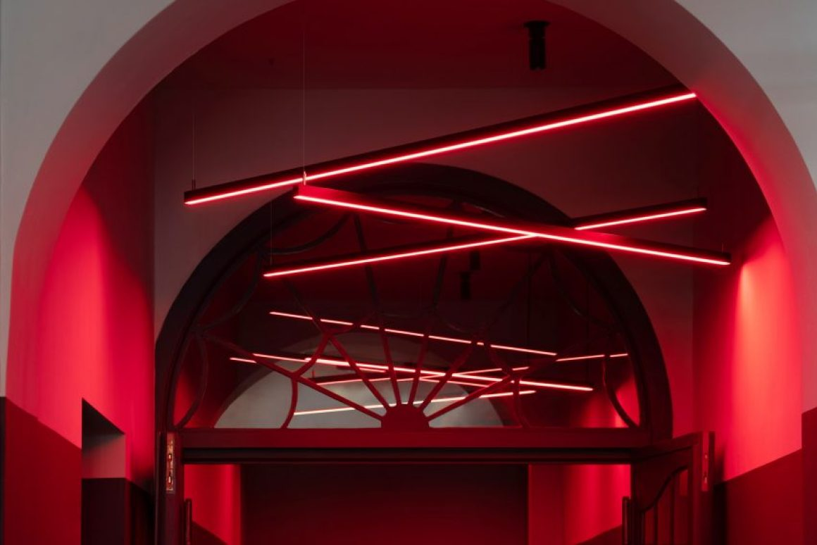 Neon lights decorate a red ceiling