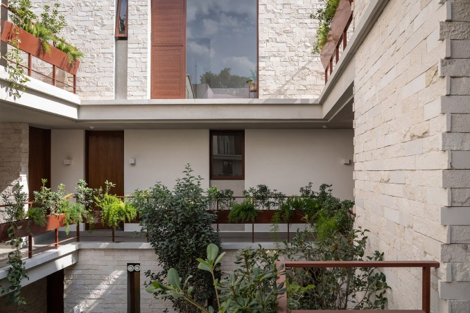 "Plants define the ""secret garden"" within the building"