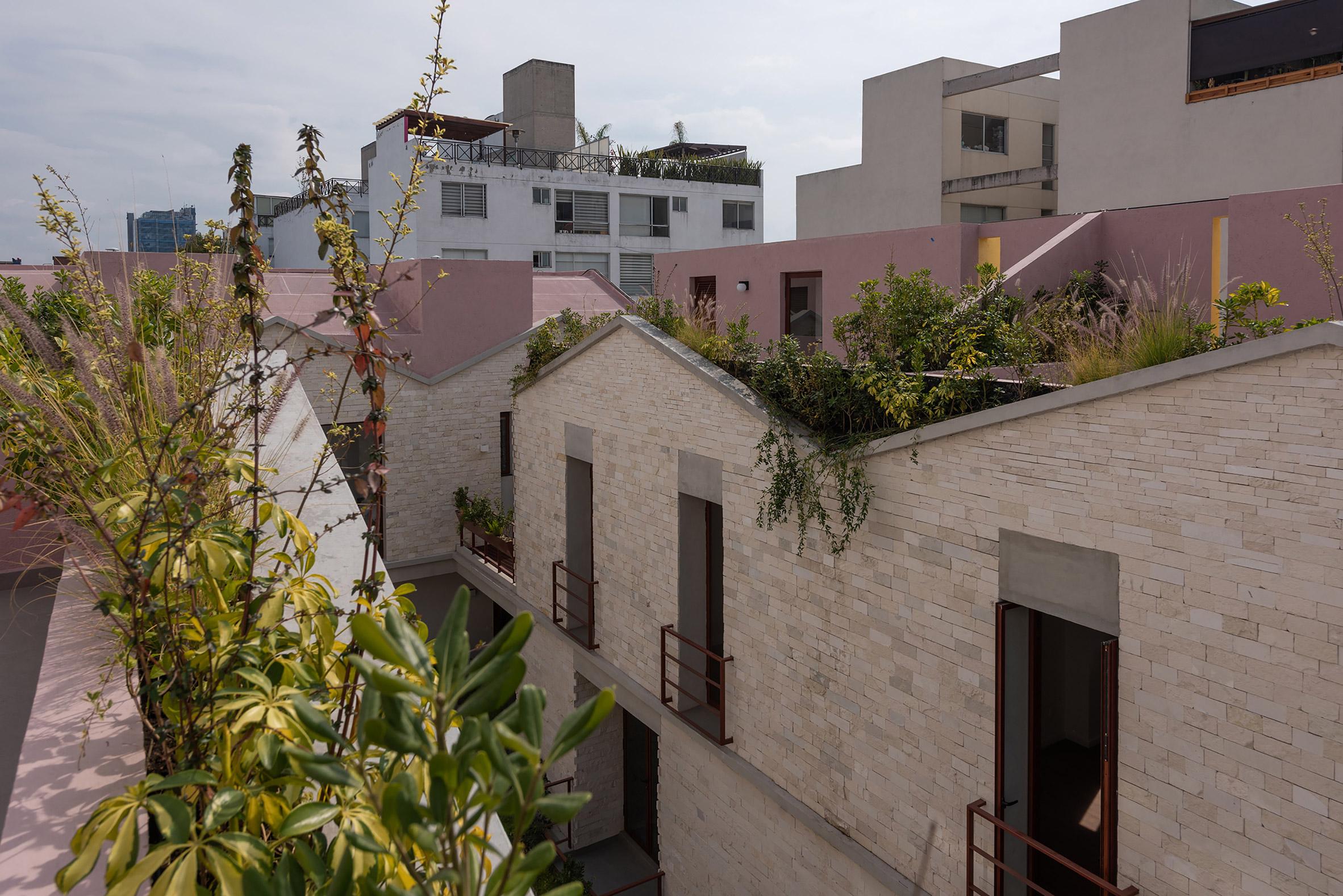 The team created triangular balconies that jut over a sidewalk