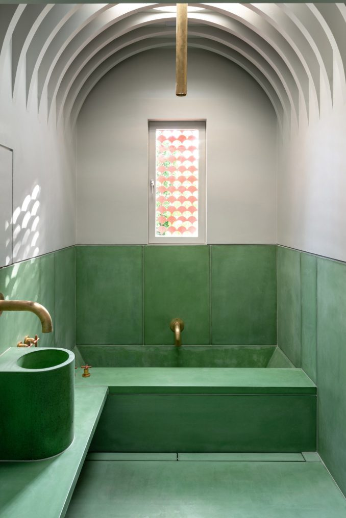 A green and white concrete bathroom