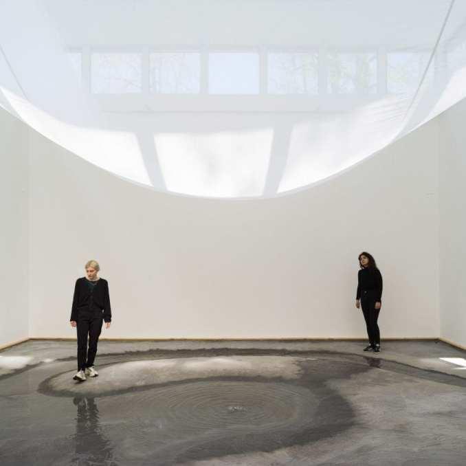 A sheet drapes across the interior of the Danish Pavilion