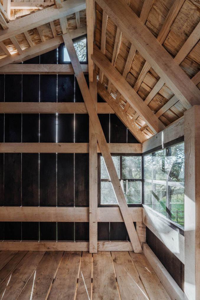 Treehouse interior showing English ash frame and scorched larch cladding