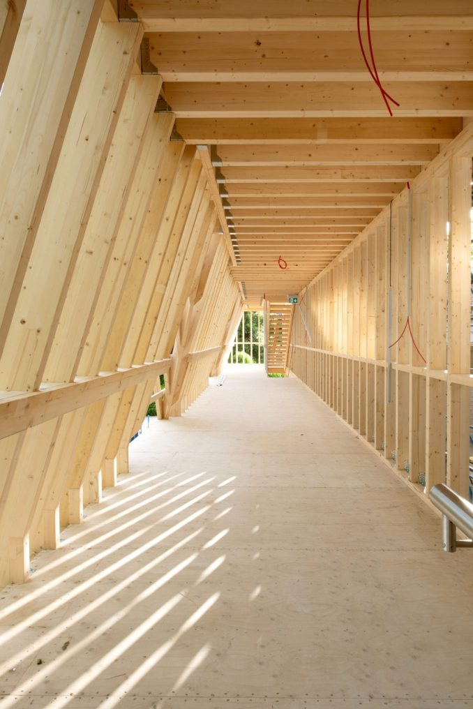 The US pavilion contrasts with its wooden installation