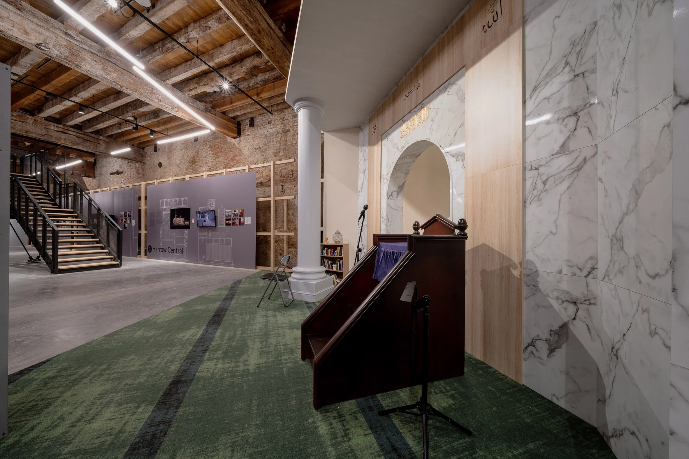 Marble panels cover the walls of the installation