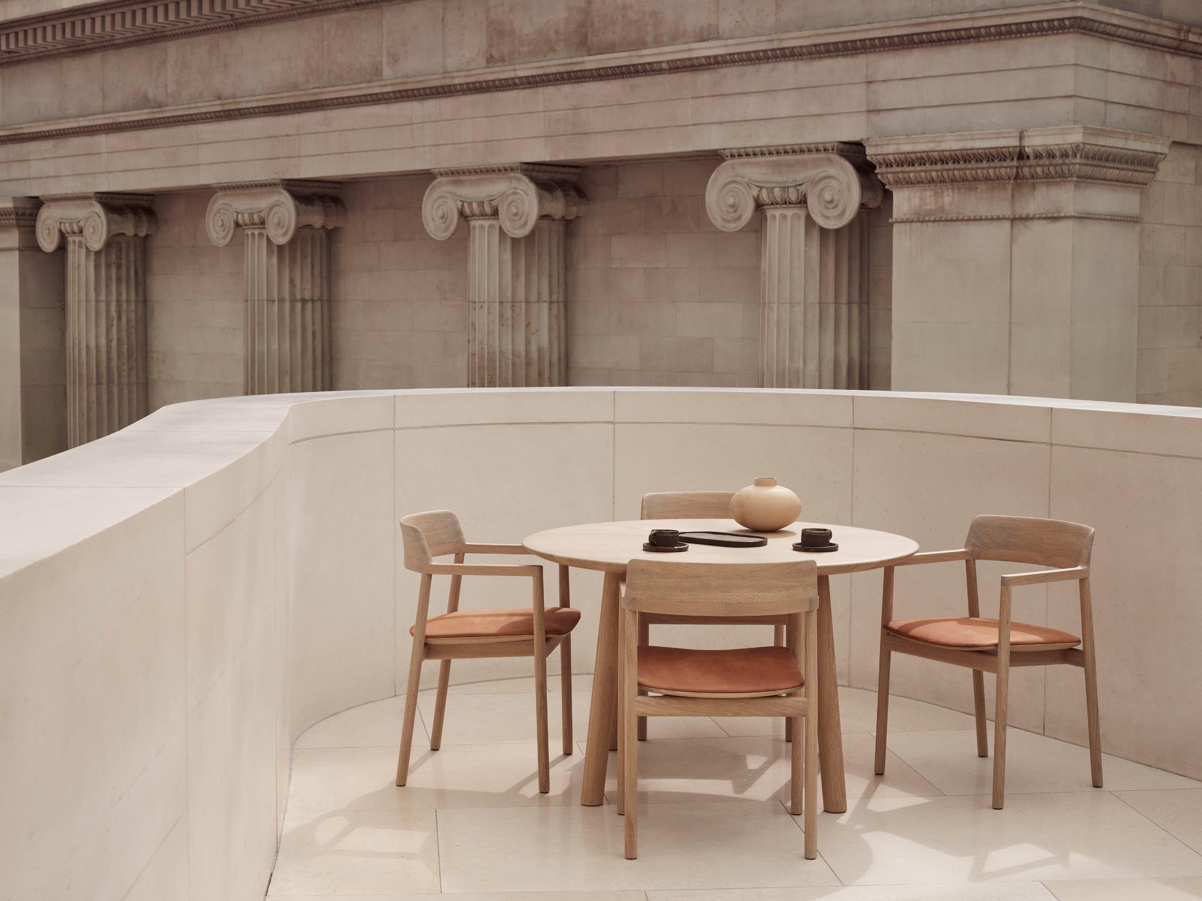 The chairs are place around a circular table