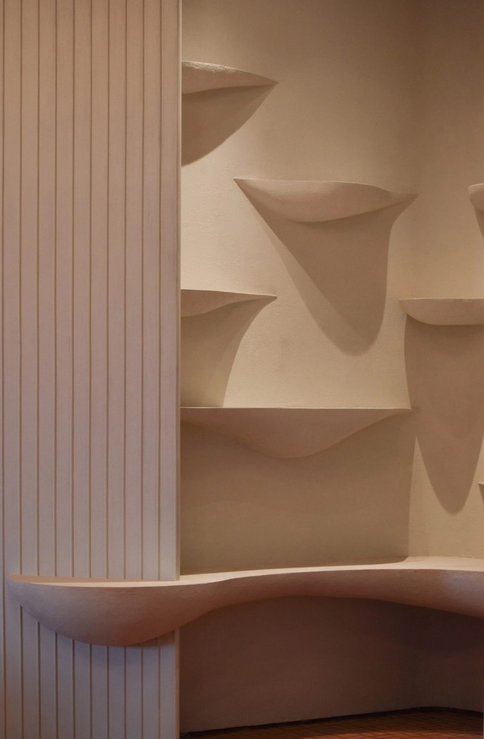 Integrated white shelving in restaurant interior by Ashiesh Shah