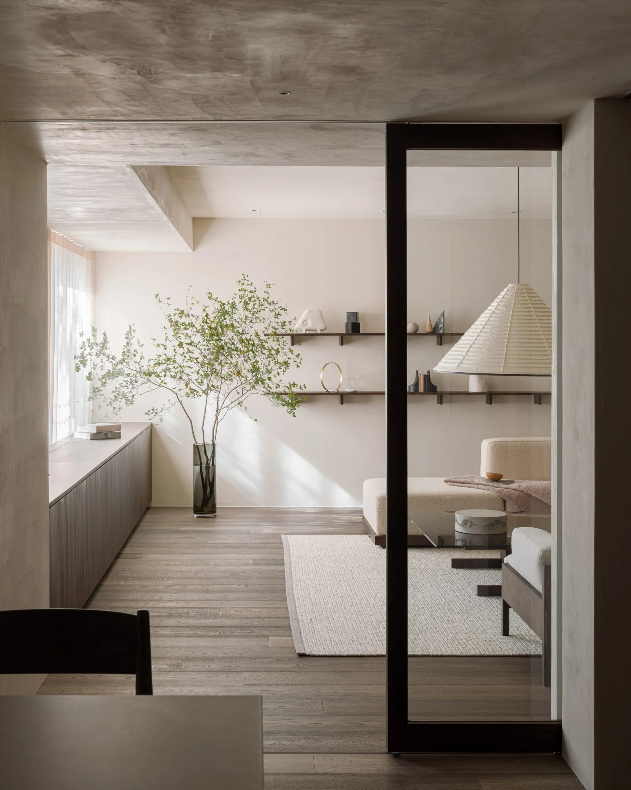 Wooden floor and white rug in Tokyo apartment
