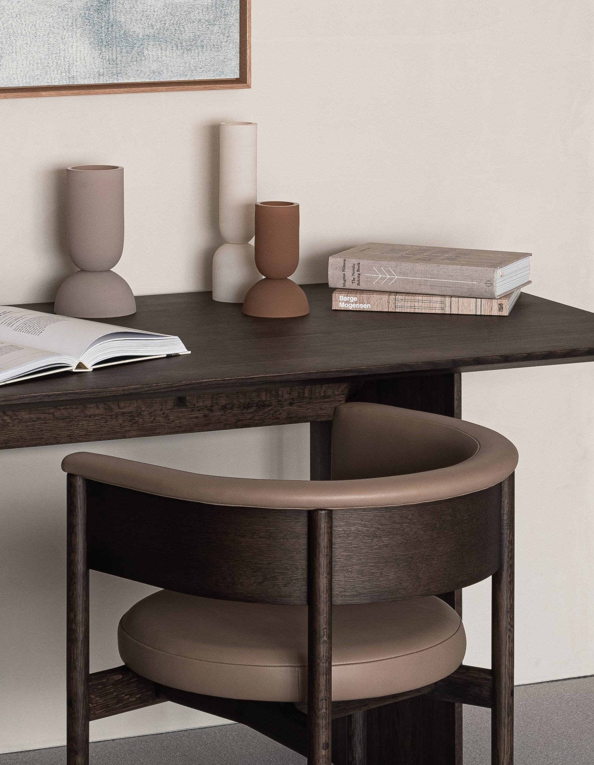 A small dark wood desk with wooden chair