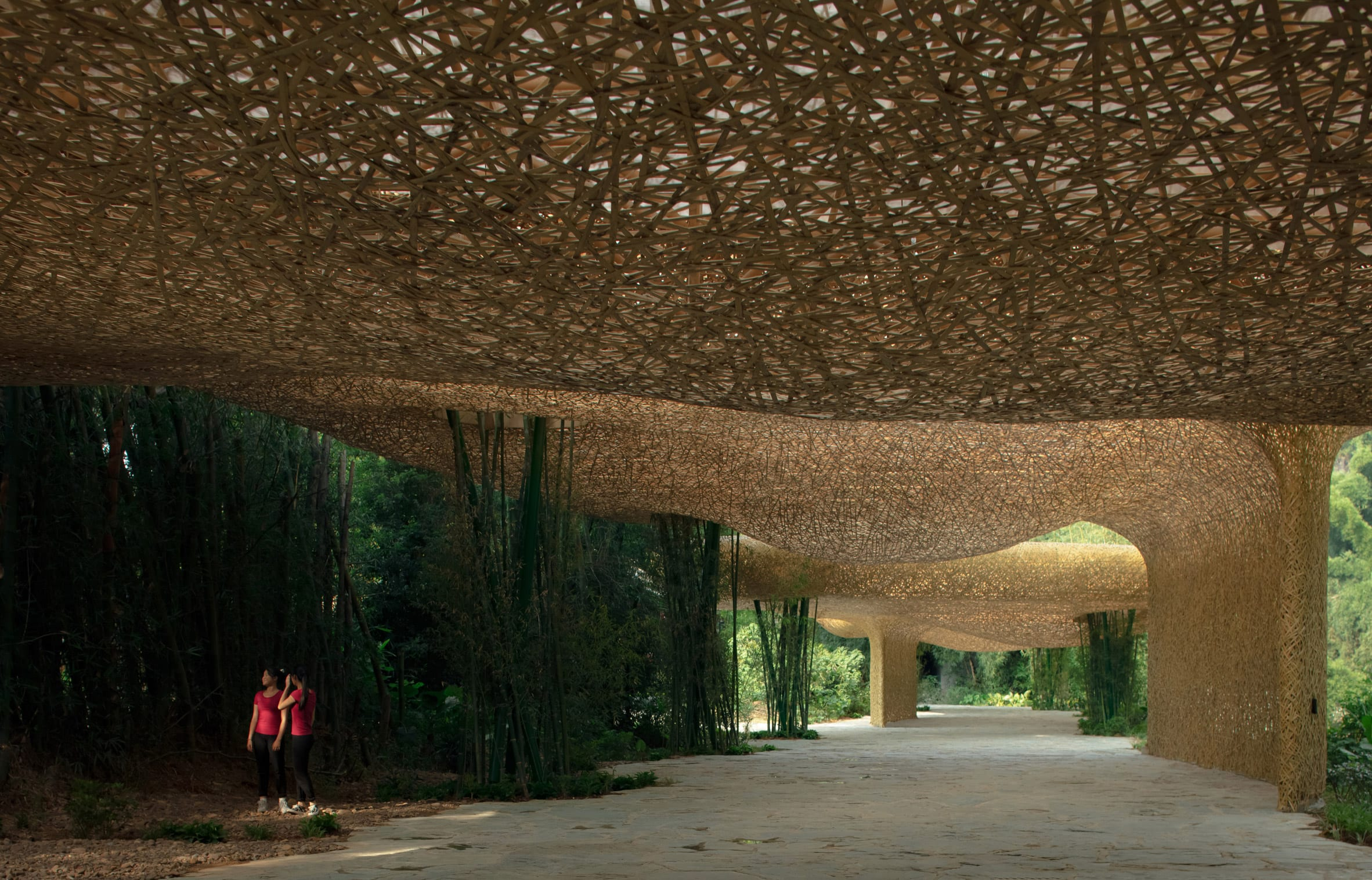 A walkway is formed beneath the pavilion by llLab.