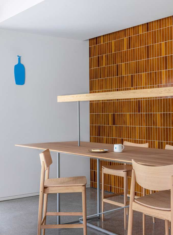 Brow-tiled walls and wooden counter seating in Blue Bottle Coffee Shibuya