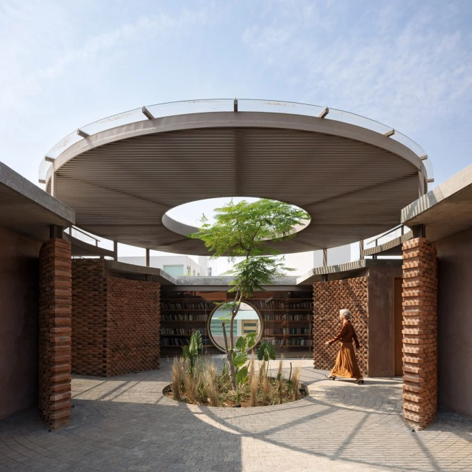 Tree growing through oculus in a courtyard canopy of a house in Mexico