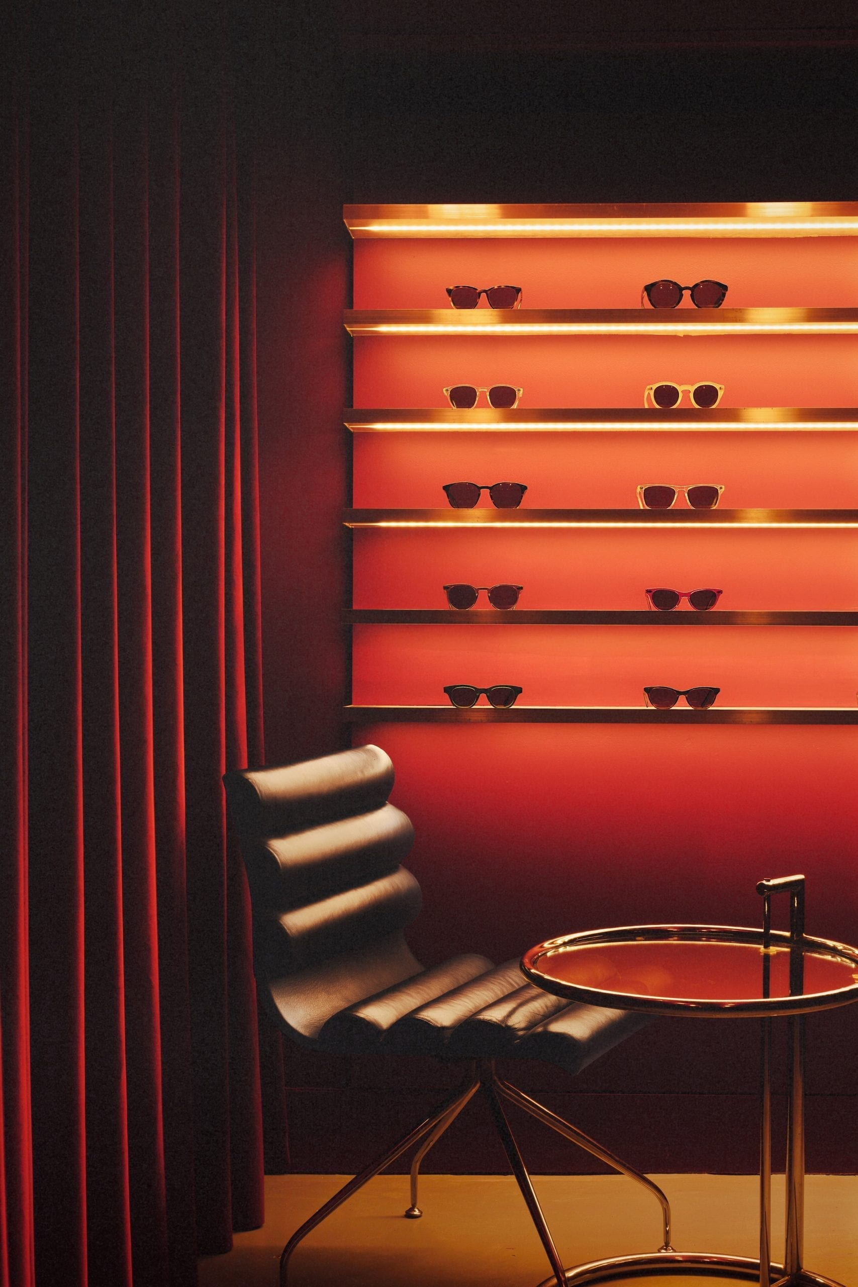 Leather chair with red glasses display in Cubitts store